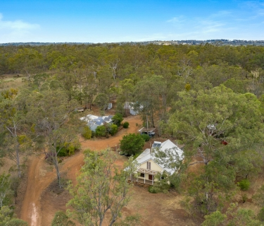 COUNTRY HIDE AWAY ON 40 ACRES WITH ABUNDANCE OF POTENTIAL!