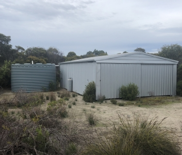 Shed and tank