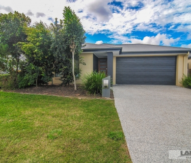 Family home with extra high double garage doors and extra carport