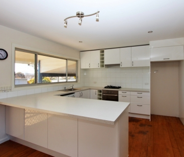 RENOVATED HOME JUST SECONDS FROM SCHOOL