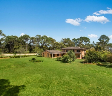 5 acre flat, elevated land with substantial home, in Somersby